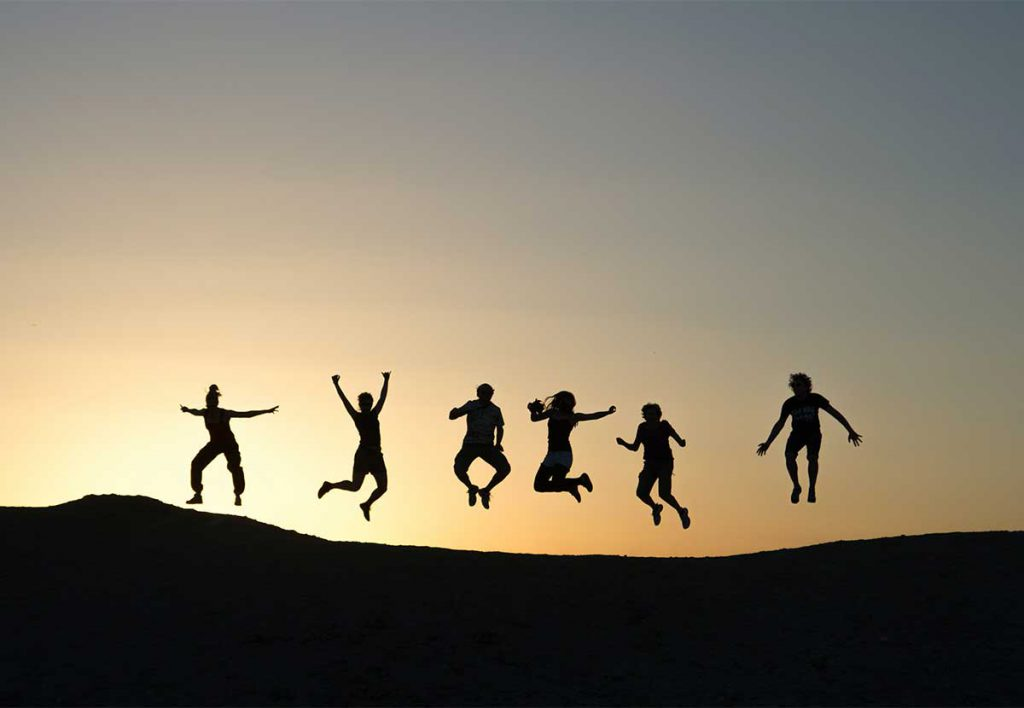 group-of-people-jumping-in-horizon
